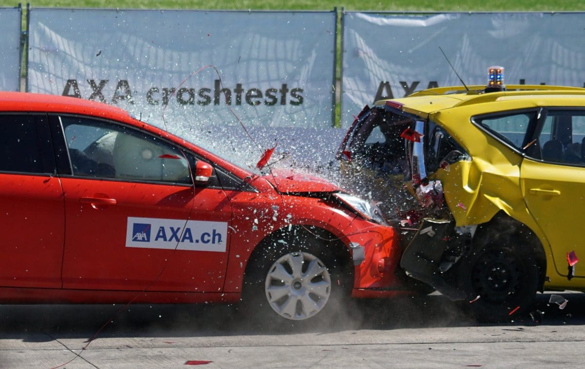 Auto crash between a red and yellow car where patients should seek chiropractic help