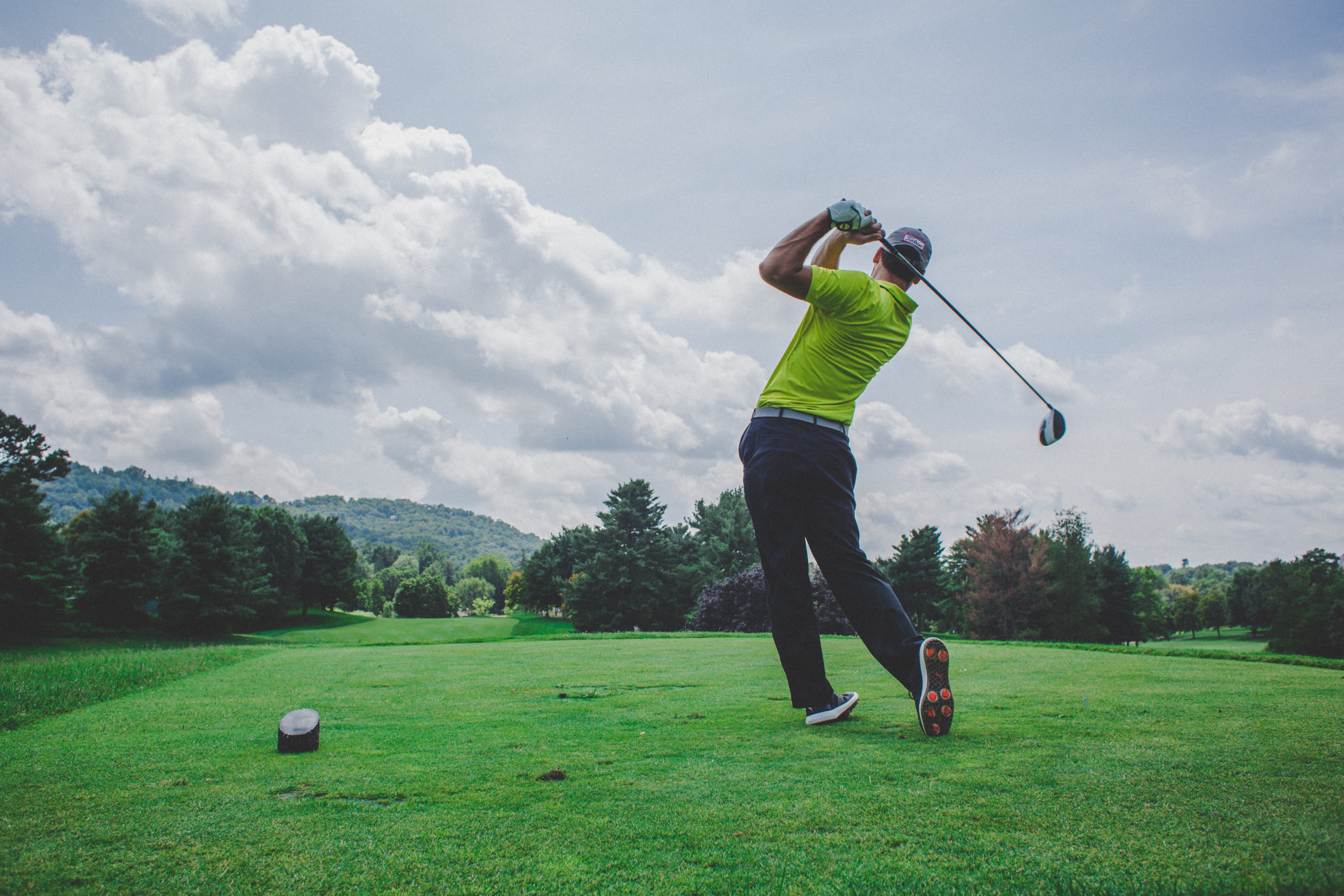 Golfer teeing off on a golf course