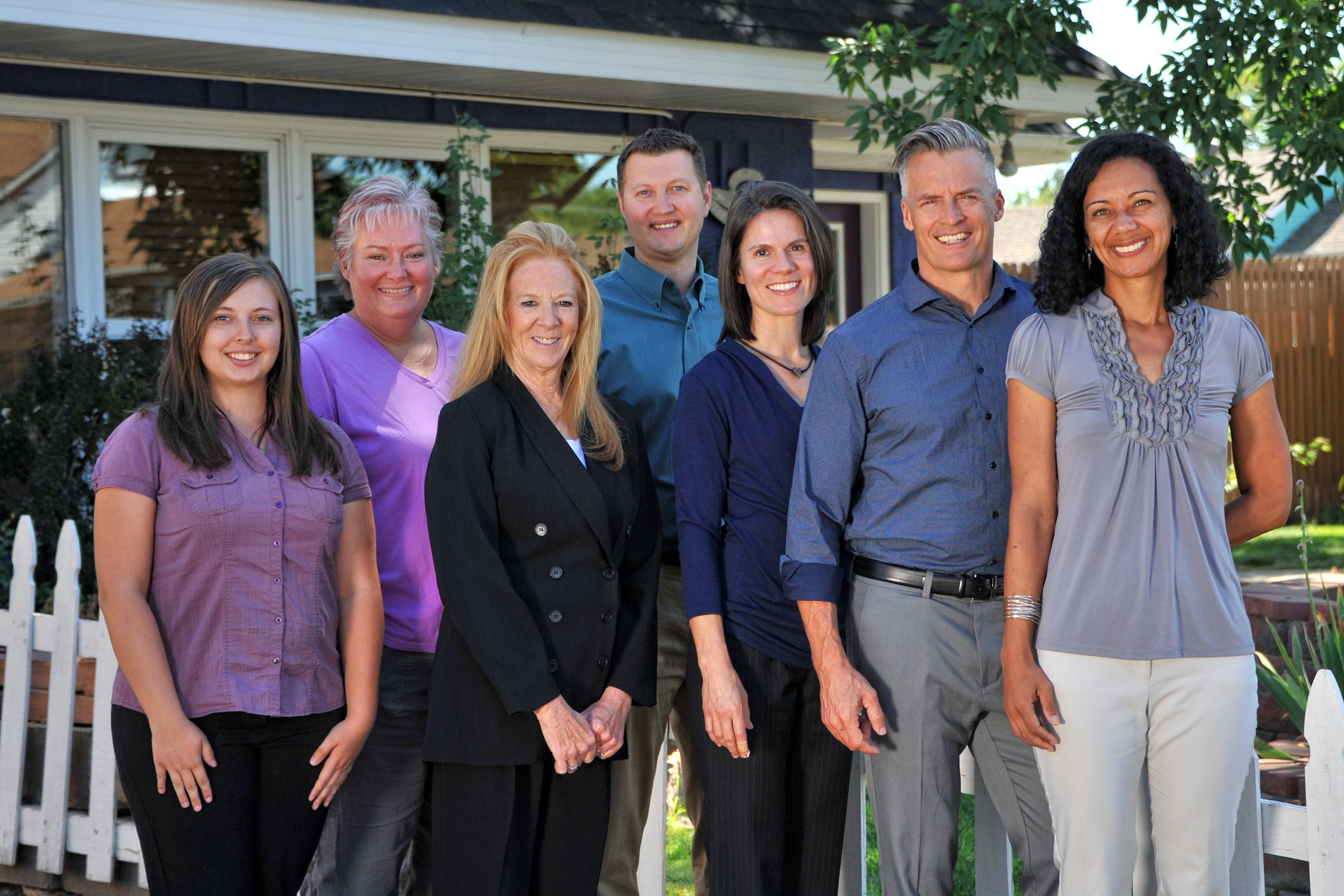 Group photo of The Chiropractic Center of Erie and Chiropractic Center of Longmont Team