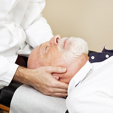 Older gentleman about to have a neck adjustment at Chiropractic Center of Longmont