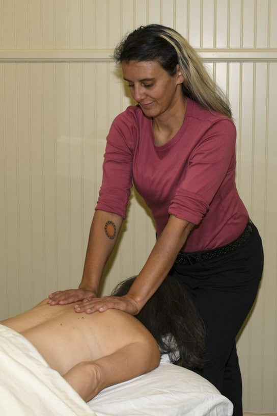 Diana King massaging a patient at Chiropractic Center of Longmont